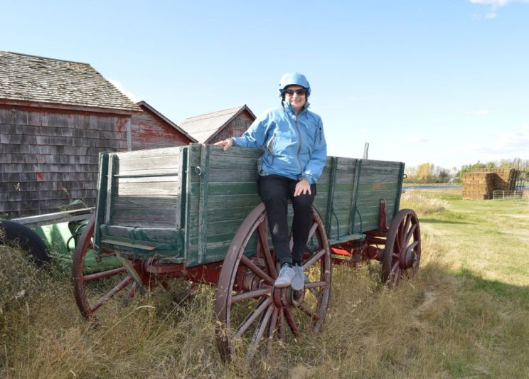 Anne on a Red River cart near Shaunavon